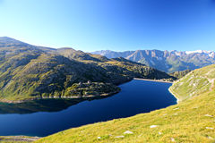 Dark alpine mountain lake Stock Photo