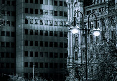 Dark Ambiance Business Tower and Historic Building and Night Street Lamp Stock Photos