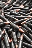 Dark ammo. Black and orange ammo background Stock Image