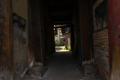 Dark ancient alley Stock Images