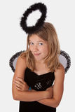 Dark angel. Cute little girl in a dress with wings and black halo Stock Photography
