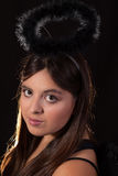 Dark Angel. Head of young brunette Hispanic teen girl with brown eyes and long hair wearing a black angel costume stock photos