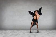 Dark angel with black wings Royalty Free Stock Image