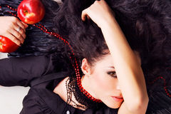 Dark angel girl with red apples Stock Images