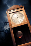 Dark antique clock at night Stock Photo