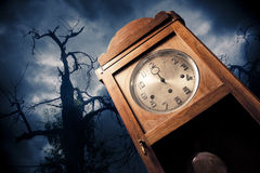Dark antique clock at night Royalty Free Stock Image