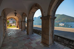 Dark archway in the old house in Perast Stock Images