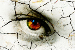 Dark art texture of a woman's eye. With cracks stock image