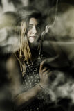 Dark artwork of a female soldier in pistol smoke Royalty Free Stock Photo