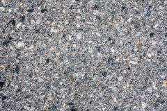 Dark asphalt with gravel texture Stock Photo