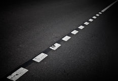 Dark asphalt road background with marking lines Stock Photography