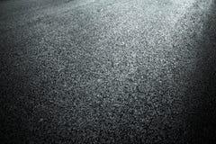 Dark asphalt roadbed. Stock Photos