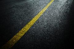 Dark asphalt roadbed. Stock Photo
