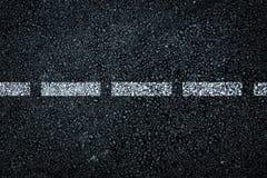 Dark asphalt roadbed. Royalty Free Stock Photos