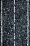 Dark asphalt roadbed. Royalty Free Stock Image