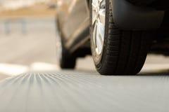 Dark automobile standing on steel floor view from below Stock Photo