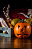 Dark autumn composition with scary pumpkins Stock Photos