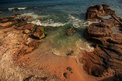 Azure Ocean Wave Surf Washes Small Bay among Rocks Royalty Free Stock Photos