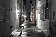 Dark back alley on a wet night Royalty Free Stock Photo