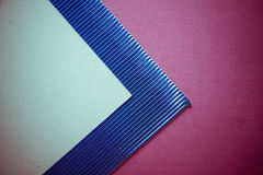 Dark background with blue and crimson paper Royalty Free Stock Photo