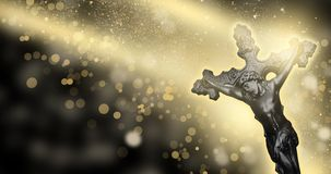 Orthodox cross on an abstract background, bokeh, rays of light. On a dark background bokeh, with gold dust, the cross is orthodox Stock Photography