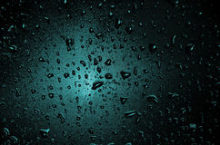 Dark background. Of a glass with waterdrops Royalty Free Stock Photography