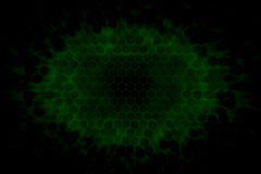 Dark background with glowing green lights shining through a 3d hexagon structure Stock Image