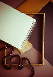 Dark background with golden fluttered paper Royalty Free Stock Image