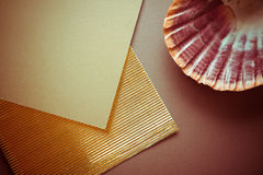 Dark background with golden fluttered paper Royalty Free Stock Photography