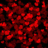 Dark background with hearts. Abstract Valentine's day background with many red hearts on black phone Stock Photo