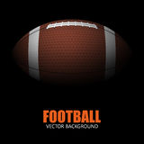 Dark background of realistic american football ball . Stock Image