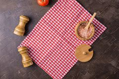 Dark background with a red serving napkin stock photography