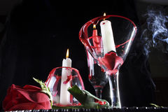 Dark background with roses, candles and red dripping Royalty Free Stock Image