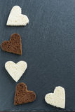 Dark background with toasted rye and white bread in heart shape Royalty Free Stock Photos