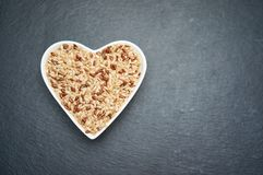 Heart shaped bowl with rice. White, wild, brown rice. I love rice concept. royalty free stock photos