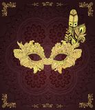 Dark background with mask with feathers Royalty Free Stock Images
