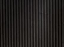 Dark background. Vertically striped black rubber background Stock Photography