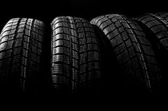 Dark background with winter tires Stock Photo