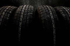 Dark background with winter tires Royalty Free Stock Image