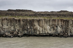 Dark basalt columns and a river running below them, Iceland Royalty Free Stock Photo