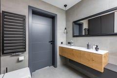 Dark bathroom with countertop basin. Dark and elegant bathroom with countertop basin and mirror stock photo