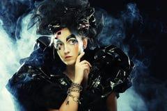 Dark Beautiful Gothic Princess.Halloween party. stock photos