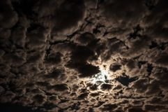 Dark beautiful night sky with clouds and the moon.  royalty free stock image