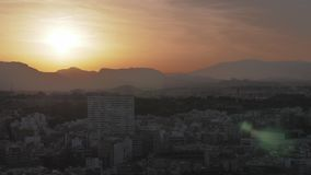 A dark sunset in Alicante. A dark and beautiful view of the sunset in Alicante. The sky is filled with dark violet and orange colors and the bright stock video footage