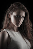 Dark beauty portrait of a young caucasian woman.  royalty free stock image