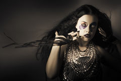 Dark beauty woman. Rich jewellery and Black Nails Stock Image
