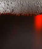 Dark beer. Macro shot of dark beer with froth Royalty Free Stock Photo
