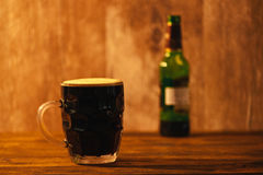 Dark beer in british dimpled glass pint mug Stock Photography