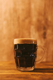 Dark beer in british dimpled glass pint mug Royalty Free Stock Images