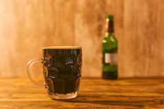 Dark beer in british dimpled glass pint mug Stock Image
